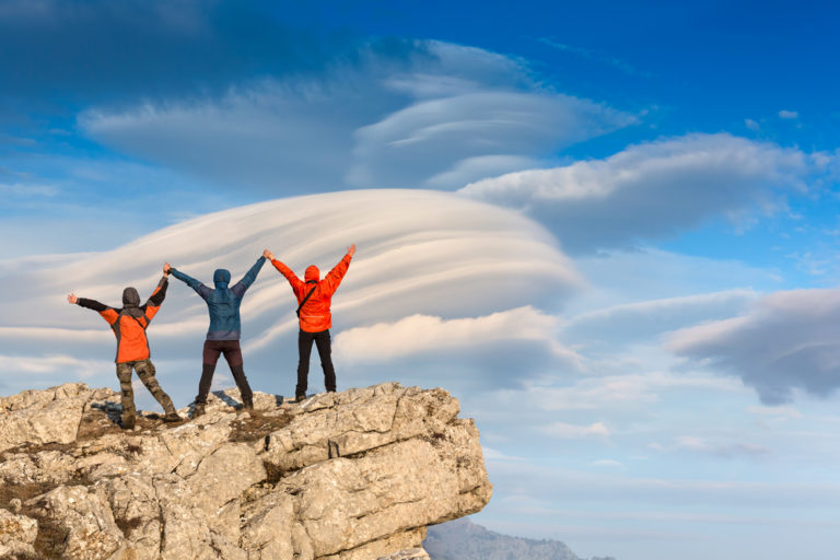 Three people on a mountain