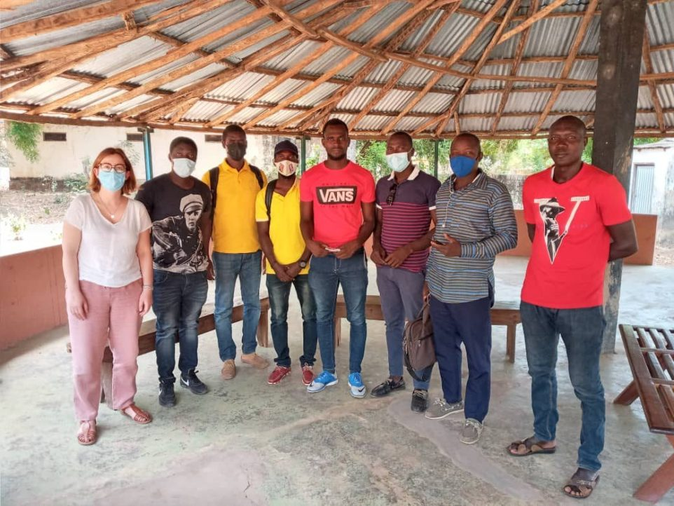 Consultant Ana Assunção with community members